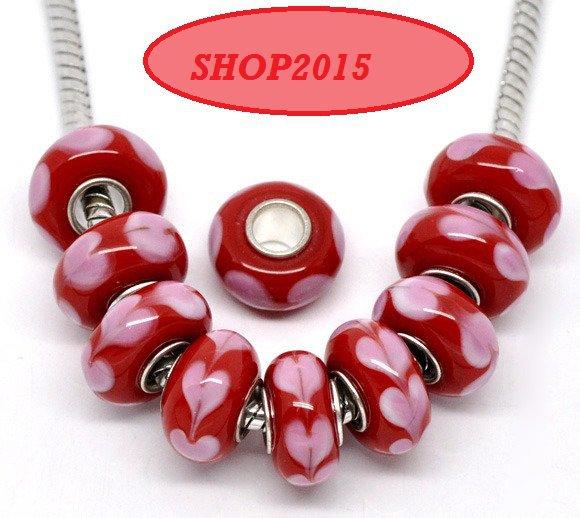 perla in vetro   a foro largo  rosso con cuori rosa 14×8 mm