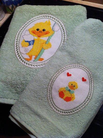 Asciugamani paperotto ricamato a mano
