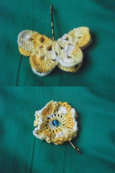 Mollette per capelli decorate con fiori e farfalle all'uncinetto, colori vari.