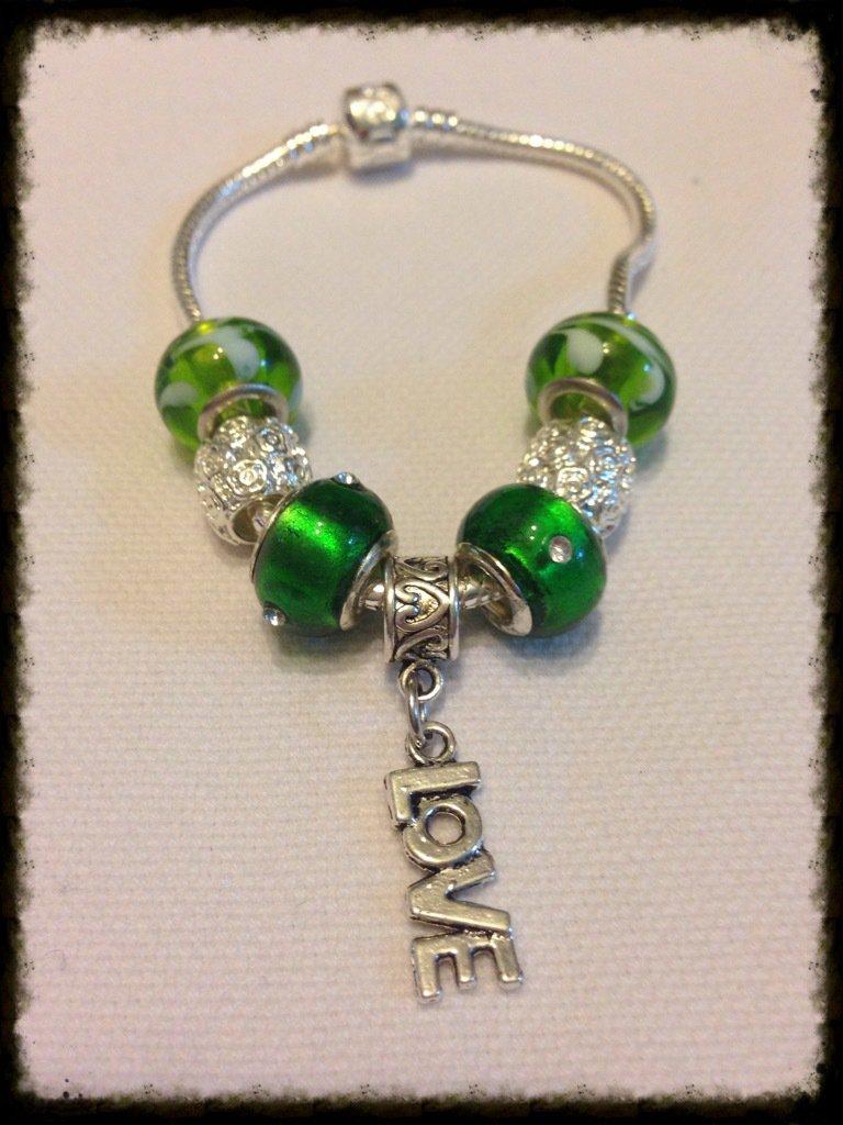 Bracciali acciaio e perle toni del verde