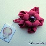 Molletta con fiore in tessuto fucsia