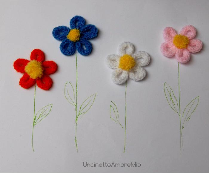 4 fiori a tricotin in lana con pon pon : decorazioni per nascite e battesimi, feste e compleanni bambini