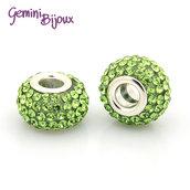 Perla a foro largo in resina, rondella con strass verde peridot, 12x9