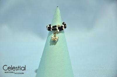 Anello molla bianco/nero con farfallina