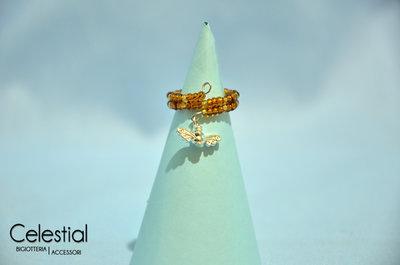 Anello molla bronzo/oro con ali