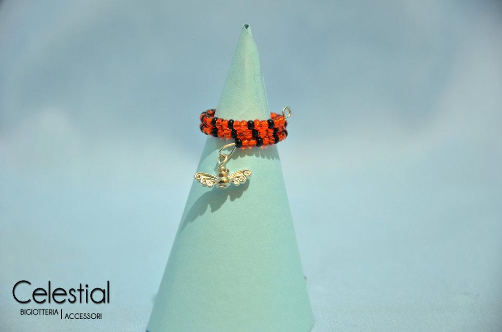 Anello molla arancione/nero con ali