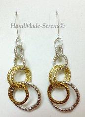 orecchini pendenti con anelli oro argento e bronzo