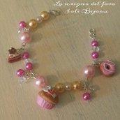 Bracciale con dolcetti in fimo e perline rosa