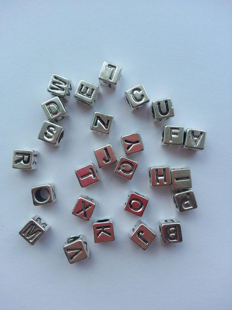 Lotto 70 lettere con foro argento