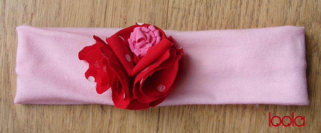Fascia per capelli rosa con fiori di stoffa