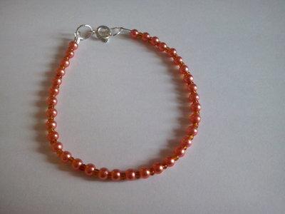 Braccialetto con perline arancio