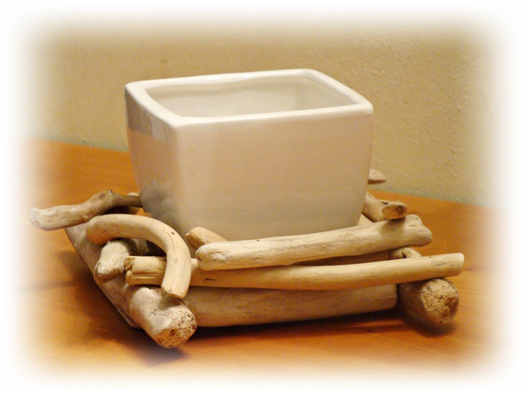 VASO in ceramica con legni di mare