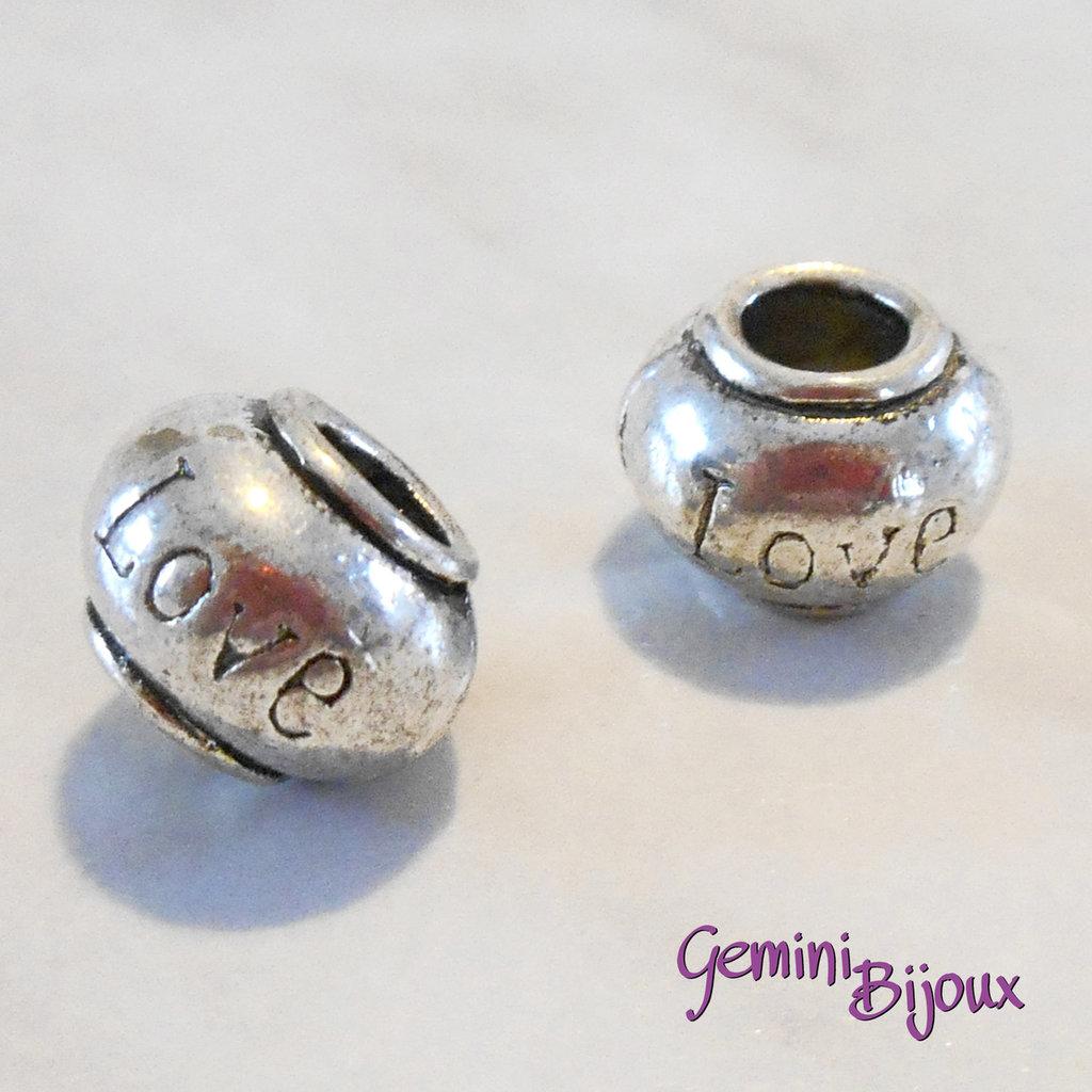 Perla tibetana in alluminio argentata a foro largo, mm 11x8. LH22