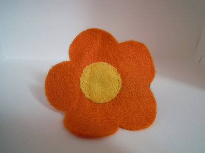 Ferma coda fiore arancio/viola