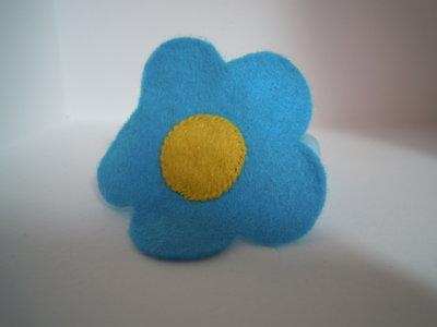 Ferma coda fiore azzurro/celeste