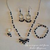 Parure cristalli bicono color argento e mezzo cristallo nero - collana, bracciale, anello, orecchini