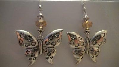 Orecchini cristalli e farfalle