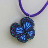 Collana con Farfalla azzurra. Necklace with blu butterfly pendant.