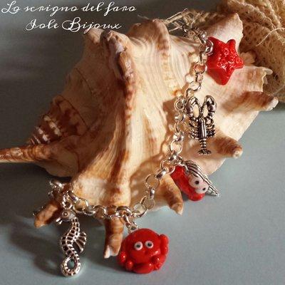 Bracciale stile marino con ciondoli in fimo granchietto, paguro, stella marina