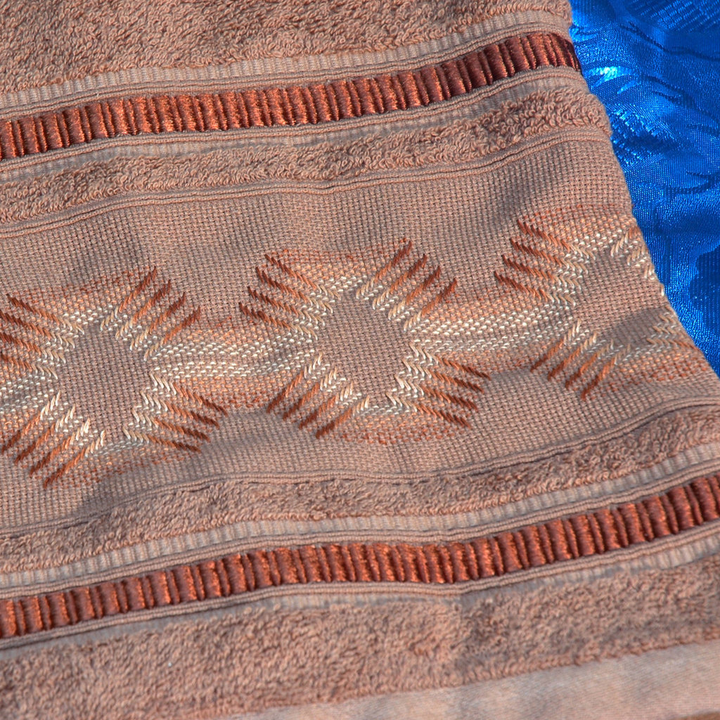 Asciugamani ricamati punto filza