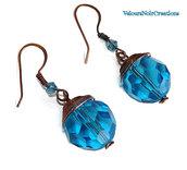 Orecchini in rame anticato e perle in cristallo sfaccettato azzurro