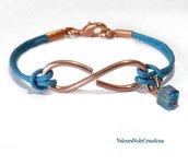 Bracciale infinito in rame e cristallo azzurro