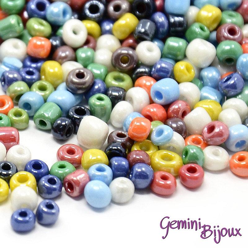 Lotto da 50 grammi perline conteria in vetro 4 mm. colorate effetto ceramica