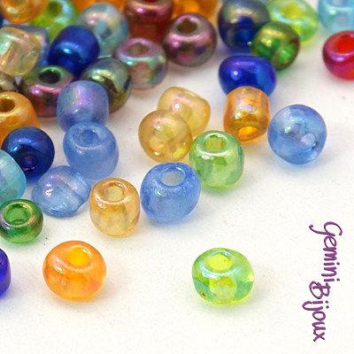 Lotto da 50 grammi perline conteria in vetro 4 mm. colorate trasparenti
