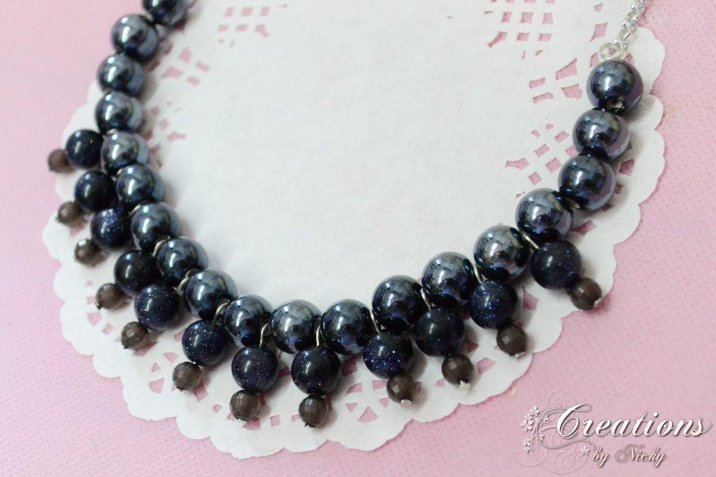 Collier con perle e pietra del sole