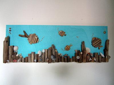 Quadro con legnetti di mare  e conchiglie