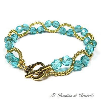 Bracciale verde ottanio e oro con mezzi cristalli e perline fatto a mano - Gelsomino