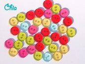 30 bottoncini colorati trasparenti a due fori