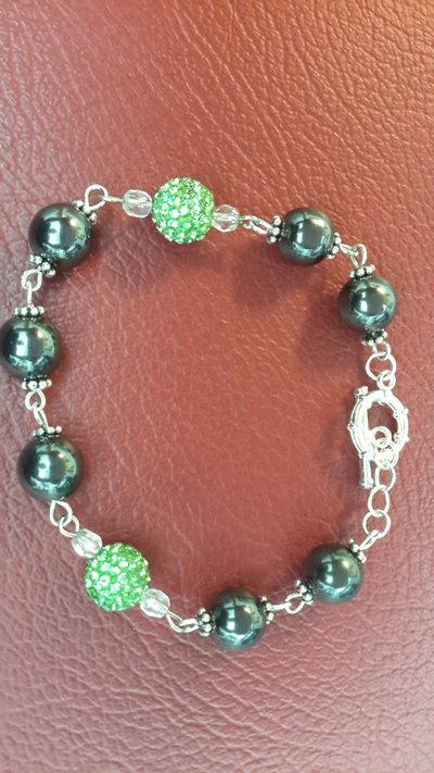 Bracciale  con pietre  dure vere, ematite e perline in pavè di cristalli