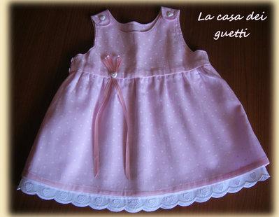 Abitino in cotone rosa con cuoricini bianchi e merletto bianco