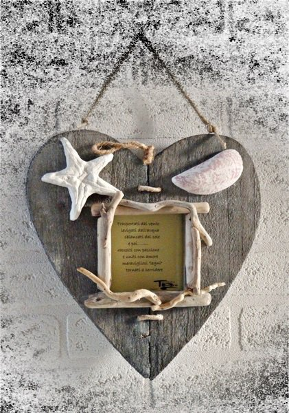 Portafoto con legni di mare e decorazioni in gesso