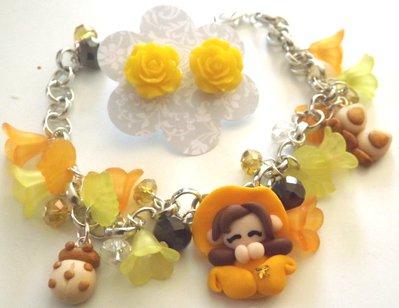 Bracciale folletta,fafalla,coccinella in fimo con fiori in lucite toni del giallo idea regalo per lei