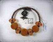 Bracciale Semirigido con perle a foro largo arancione e perline in bronzo fatto a mano