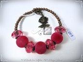 Bracciale Semirigido con perle a foro largo fucsia e perline in bronzo fatto a mano