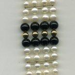Bracciele a 4 fili in perle di fiume e onice