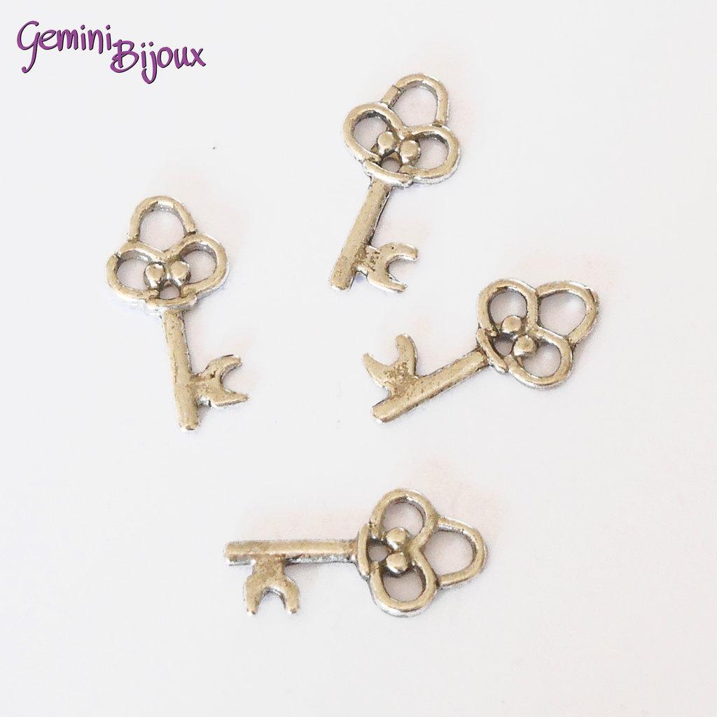 Charm chiave stile tibetano argentato 10x20 - K036