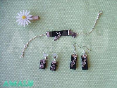 Bracciale e orecchini con chiave di violino
