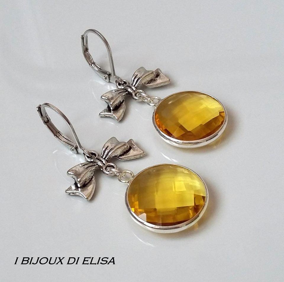 Orecchini con fiocchetto e mezzo cristallo giallo