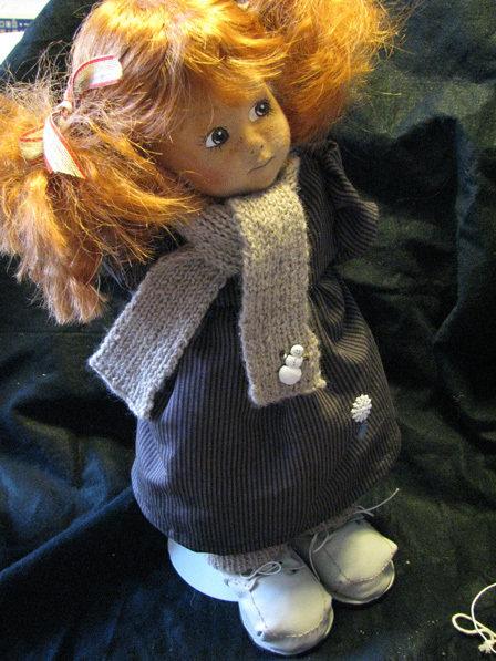 Bambola in stoffa dipinta