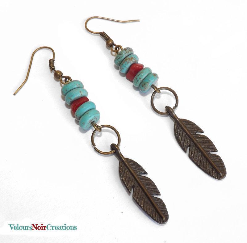 Orecchini nativi americani con piuma e turchesi