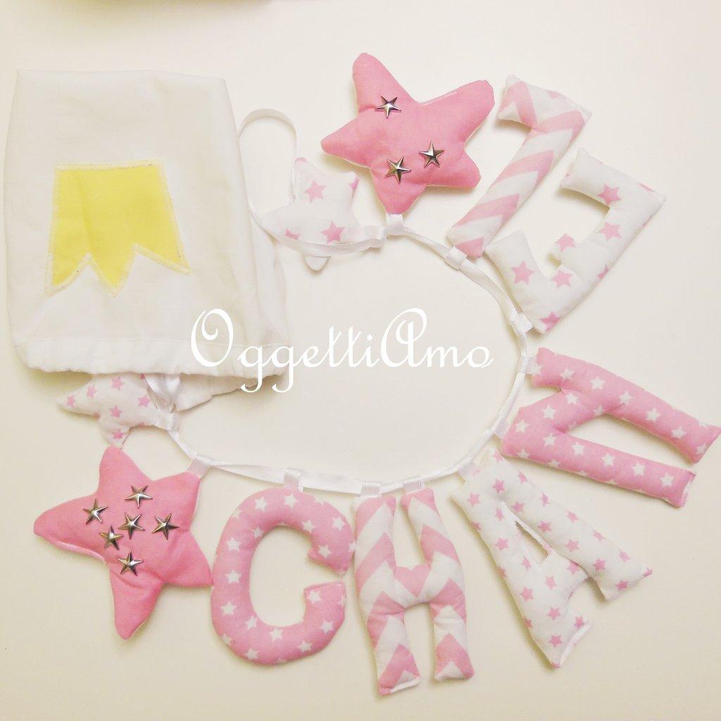 Chanel: una ghirlanda di lettere di stoffa imbottite a stelle rosa e bianche!