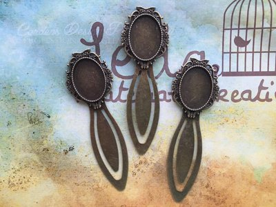 Segnalibro vintage con base cammeo in bronzo