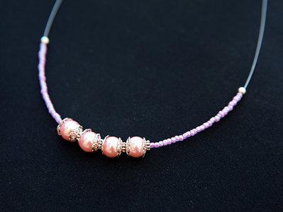 Collana Girocollo con cavetto d'acciaio e perle di vetro