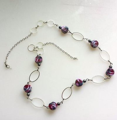 Collana con perle di fimo e ovali