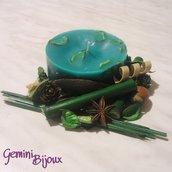 Candela verde con decorazione pot pourri e anice stellato