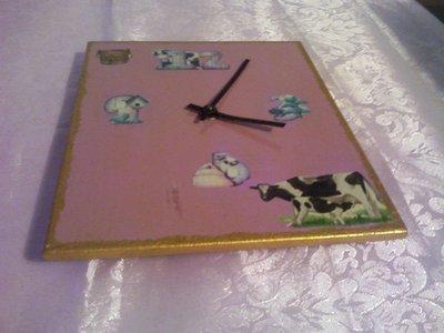 Orologio viola con mucche